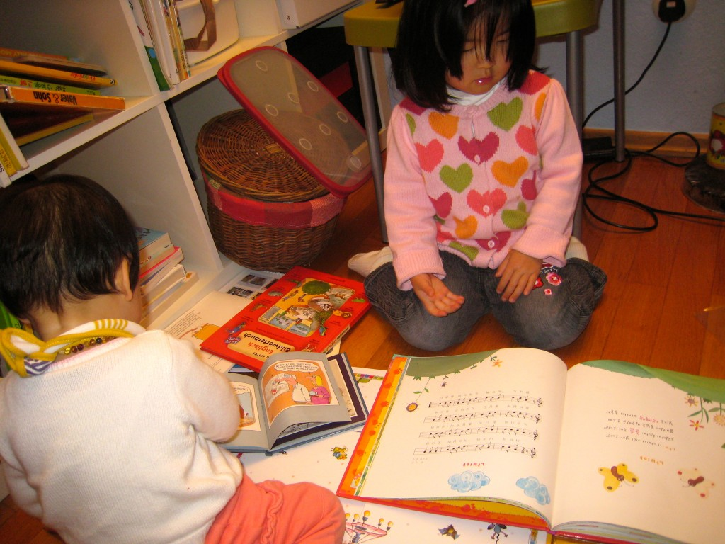 It can get chaotic, but putting lots of language books in front of kids can in fact help their language skills!